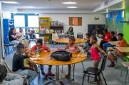 woman men and children enjoy pizza at new neighborhoods summer kickoff