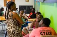 men women and children eating at new neighborhoods summer kick off