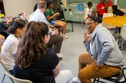 women talking at new neighborhoods summer kick off