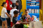 young children with presents at new neighborhoods summer kick off