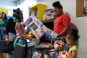 young girls with gifts at new neighborhoods summer kickoff
