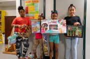group of girls with toys and gifts at new neighborhods summer kick off