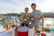 Marketing Representatives holding whiskey bottles