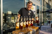 Wild Moon Whiskey representative holding up a bottle