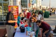 Beer vendors helping patrons taste test