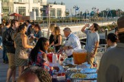 Groups of people trying food, beer, and whiskey