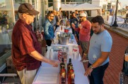 A man serving whiskey at the Stamford Brew fest