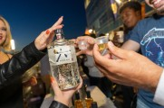 Suntory Roku Gin bottle being held up by a woman