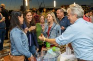 A group of women sharing a toast at the Stamford Brew and Whiskey Festival