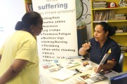 Woman Teaching Another Woman at 2016 Health Fair