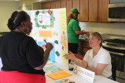 Senior Nutrition Table Informing A Woman at 2016 Health Fair