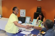 Two Women Smiling and Shaking Hands at 2016 Health Fair