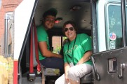 Woman and Boy Smiling Inside a Truck at the 2016 Health Fair