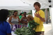 Man Getting Swiss Chard at Health Fair 2016