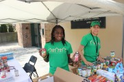Two Female Staff Members Collecting Food for A Food Bank at the 2016 Health Fair