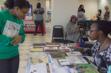 woman at information table at 2017 healthy harvest