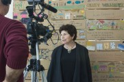 Woman Getting Interviewed In Front of Positive Art Work At The 2016 Home Project