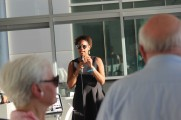 Woman Speaking To The Crowd On Microphone At The 2016 Jazz On The Rocks