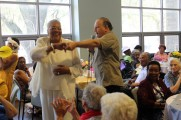Man On Microphone Dancing With A Woman at The Senior Prom Luncheon 2016