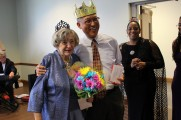 Man and Woman Smiling Wearing Crowns at Senior Prom Luncheon 2016