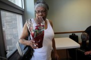 Woman Holding A Pot of Flowers at Senior Prom Luncheon 2016