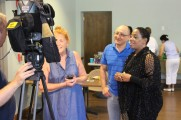 Man and Two Women Being Filmed at Senior Prom Luncheon 2016