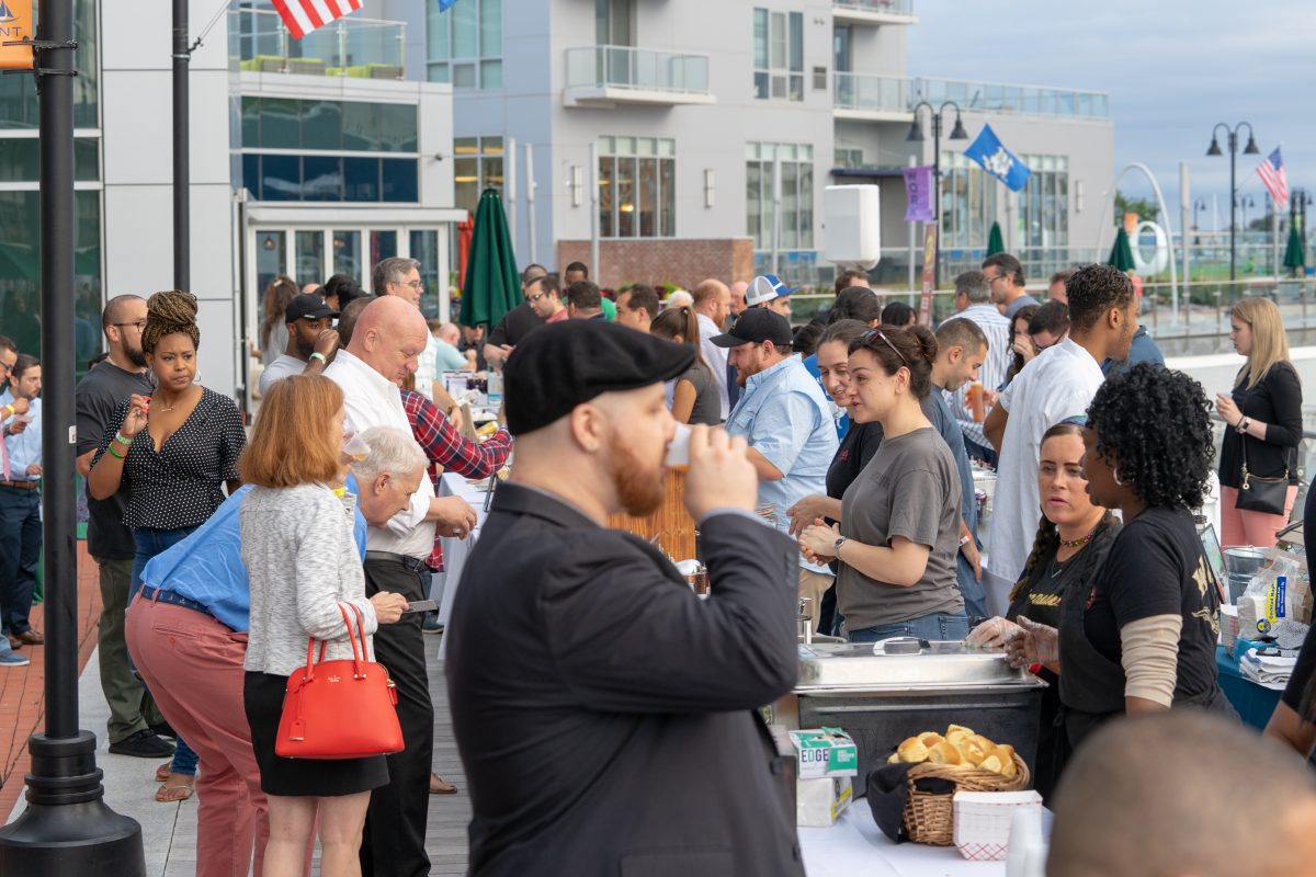 vendors and patrons interact at stamford brew and whiskey festival 2018 new neighborhoods