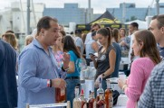 vendor talks to patrons about whiskey at stamford brew and whiskey festival 2018
