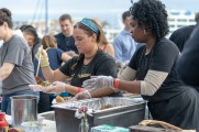 Vendors prepare food at stamford brew and whiskey festival 2018