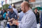 man pours whiskey at stamford brew and whiskey fest 2018