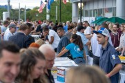 Men and woman order food and drinks from vendors at stamford brew and whiskey festival 2018