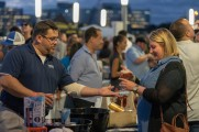 woman gets whiskey from samuel adams vendor at stamford brew and whiskey festival 2018