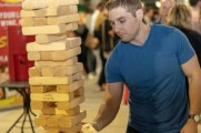 man plays jenga at stamford brew and whiskey festival 2018