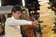 woman watches man play jenga at stamford brew and whiskey festival 2018