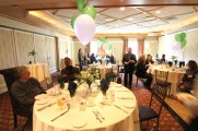 Tables of Men and Women at The Waters Edge Staff Event