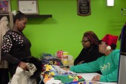 Staff Helping Young Girl at 2016 Winter warmup