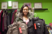 Woman Holding Two New North Face Coats At The 2016 Winter Warmup