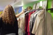 Women Looking At Coats On Metal Coat Rack At 2016 Winter Warmup