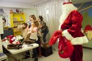 Santa Watching The Kids Take Photos With Props at 2016 Winter Warmup