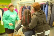 Woman and Two Girls Speak With Staff Member at The 2016 Winter Warmup