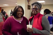 Women Smiling Holding Hot Chocolate at the 2016 Winter Warmup