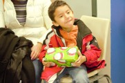 Little Boy Smiling Holding A Gift At The 2016 Winter Warmup