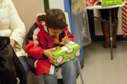 Young Boy Opening Gift At 2016 Winter Warmup