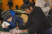 Young Girl and Boy Participate In Activity At Winter Warmup 2017
