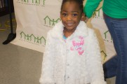 Young Girl Smiles With New Coat At Winter Warmup 2017