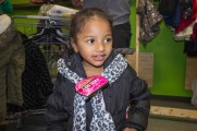 Young Girl Smiles With New Scarf and Jacket at Winter Warmup 2017
