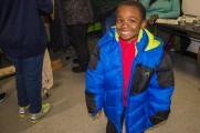 Young Boy Smiles With New Coat At Winter Warmup 2017
