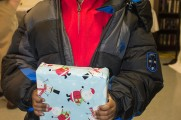 Young Boy Smiles With Gift At Winter Warmup 2017