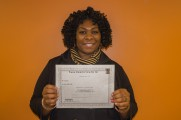 Woman Holds Certificate and Smiles at Winter Warmup 2017