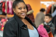 woman smiles at winter warm up 2018 new neighborhoods